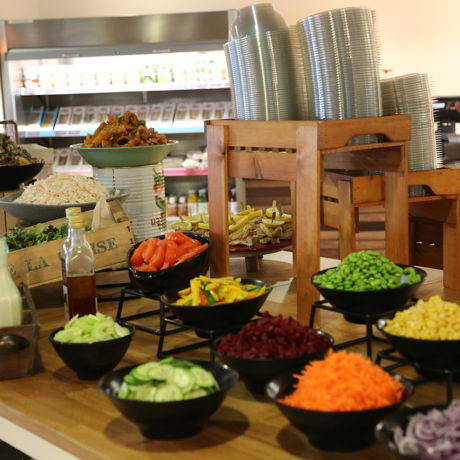Bowls of brightly coloured salad ingredients at the buffet salad bar