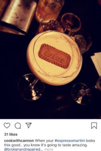 A cocktail with a biscuit floating on top
